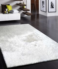White Long Soft Area Rug is Made with durability and Fashion of home Decor in mind, With an irresistibly soft pile and wonderful palettes, it brings warmth to every decor.And it's measurements are 2' x 3' ft. http://rugaddiction.com/collections/all-shag-rugs/products/white-long-soft-durable-shag-area-rug