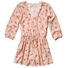 Hollister Printed Wrap Front Romper (770 RUB) ❤ liked on Polyvore featuring jumpsuits, rompers, pink floral, pink floral romper, floral rompers, wrap front romper, v neck romper and flower print romper