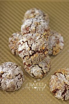 Chocolate Peanut Butter Crackles are soft chocolate cookies filled with peanut butter cups and rolled in crushed peanuts and powdered sugar.