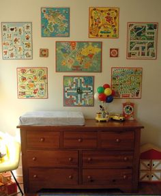 Love the wall collection of vintage board games. I have already started my collection to do a similar look in a play room.