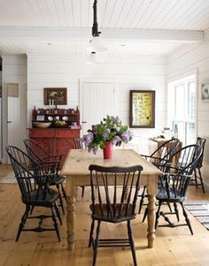 farmhouse table with black chairs by leila