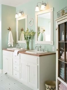 Double Sinks @ Home DIY Remodeling, nice paint color for a bathroom too. Like the double mirrors instead of one and the trim on doors
