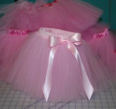 This is the tutu skirt tutorial that I have been looking for. It is detailed and is not the knot version on elastic.