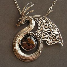 """""""Dragon Protector"""" Tin-plated copper and garnet necklace. Wire Wrapped Jewelry, Metal Jewelry, Jewelry Art, Silver Jewelry, Jewelry Accessories, Jewelry Necklaces, Jewelry Design, Dragon Necklace, Dragon Jewelry"""