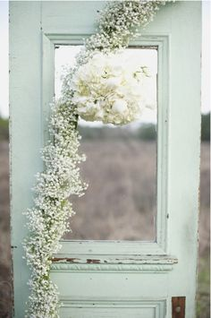 Baby's breath + White Carnations against mint backdrop