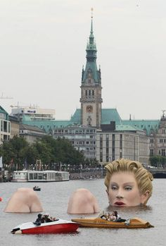 """Oliver Voss' sculpture titled """"The Bather"""" is installed in Binnenalster lake in Hamburg Germany."""