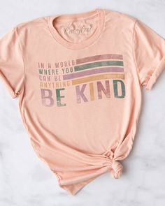 Christian tees to Style Your Faith! Design: In A World Where You Can Be Anything Be Kind Ephesians 4:32Be kind to one another, tenderhearted, forgiving one another, as God in Christ forgave you. FIT: Unisex and runs true to size Material: 4.0 oz., 100% combed ringspun cotton, 30 singles Peach Tee Size Bust/Chest Inches Small 34-36 Medium 38-40 Large 42-44 XL 46-48 XXL 49-51 Cute Graphic Tees, Graphic Shirts, Cute Tshirts, Cool Shirts, Trendy T Shirts, Cute Sayings For Shirts, Cute Teen Shirts, Shirt Sayings, Trendy Outfits