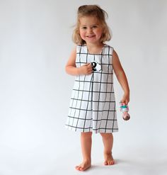 An A-line jersey dress with a box pleat and faux flap pocket, easy to sew and doesn't require a closure. You can alternate with the wrap bodice or create a completely different look with the reversible dress. For boys or tough girls there is the harem. Sewing Patterns For Kids, Clothing Patterns, Pdf Patterns, Kids Clothing, Cute Outfits For Kids, Toddler Outfits, Little Girl Dresses, Girls Dresses, Fashion Kids