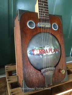 Terraplane guitar made with heavy duty hubcap, discarded walnut drawer and door skin for the box, and a pickup I'm designing based in the old gold foil pickups… Guitar Rack, Cool Guitar, Guitar Pins, Guitar Shop, Unique Guitars, Vintage Guitars, Cigar Box Guitar Plans, Resonator Guitar, Homemade Instruments