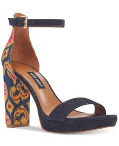 Nine West Dempsey Two-Piece Platform Sandals $89.00 Colorblocked with an eye-catching patterned heel, the Dempsey platform sandal from Nine West elevates a chic look for a fun night out.