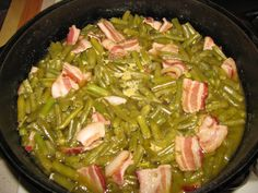 Southern green beans are easy to make, tender beans that are flavored with bacon or ham hocks. These green beans are a must-have side dish on every Southern table. Green Beans With Bacon, Cooking Green Beans, Frozen Green Beans, Southern Style Green Beans, Southern Greens, Vegetable Side Dishes, Vegetable Recipes, Veggie Meals, Bacon And Butter
