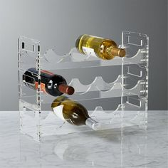 5 Ways To Use Acrylic Decor Throughout Your House // Kitchen - A simple acrylic wine rack keeps your wine close by makes it easy to see exactly what you've got.