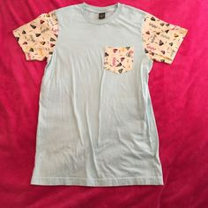 Volcom Frocket Tee There's a reason everyone loves Wes Anderson films. One word: pastels. Whether you're journeying to the Grand Budapest Hotel or shredding rails at the skate park, this fun frocket is sure to turn heads.  *Never worn **Price is firm, no trades! Volcom Tops Tees - Short Sleeve
