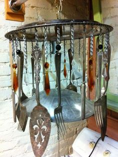 repurposed pot lids | Silver plate flatware and pot lid wind chime. Repurposed and re-loved