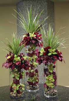 Green and purple orchids in multiple vases modern flower arrangement Flower Centerpieces, Flower Vases, Flower Decorations, Wedding Centerpieces, Flower Art, Table Wedding, Wedding Reception, Modern Centerpieces, Tall Centerpiece