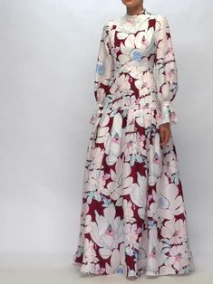 The magnified floral pattern illustrating Carolina Herrera's white and burgundy Orleander gown heightens the impact of the striking couture-inspired silhouette. It's crafted in the USA from heavyweigh Abaya Fashion, Muslim Fashion, Modest Fashion, Fashion Dresses, Abaya Mode, Mode Hijab, Gala Dinner, Party Wear Indian Dresses, Hijab Stile