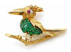 A DIAMOND, RUBBY, EMERALD YELLOW AND WHITE GOLD BIRD CLIP
