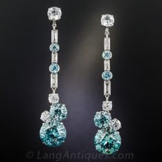 Wowzer! We've never seen anything quite like these dynamic vintage dazzlers. Clocking in at just under 3 inches long (at full length, and 1 3/8 inches minus the removable center section), these sensational showstoppers, culminate with a matched pair of huge blue zircons (about 14 carats each). These in turn are crowned by a smaller pair of blue zircons (totaling 8.50 carats), along with two pairs of diamond white zircons. This extraordinary pair will impress and amaze! Circa 1930s-40s.