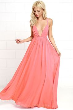 You'll soar right into our hearts with a look as splendid as the Flutter Freely Coral Pink Maxi Dress! Billowy bodice has a plunging neckline, supported by adjustable spaghetti straps and a second set of straps that cross at back and cinch the waist. Woven poly maxi skirt has a full, twirl-worthy silhouette.