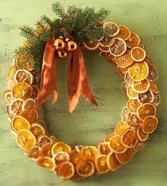 "Orange slice wreath  Dried oranges and lemons create a stunning holiday wreath. To make this wreath, cut 1/8"" slices of oranges and lemons and bake for 3 hours in a 150 degree F oven (turning once). Once the slices have cooled, attach them to a round florist's foam wreath with straight pins"