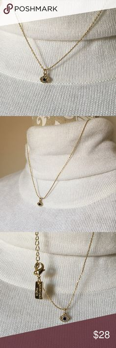 """American Eagle Eye Pendant Necklace American Eagle necklace. Gold chain with eye pendant. Eye pendant has sapphire blue center stone surrounded by white sapphire color outer stones. New! NWOT Adjustable lobster claw clasp. Measures 18"""" long. American Eagle Jewelry Necklaces"""
