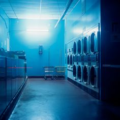 laundromat by Patrick Joust - an atmosphere of otherworldness conveyed by lighting and color temperature