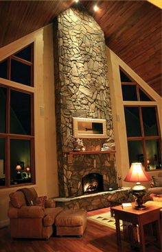 love the stone fireplace and windows...cozy