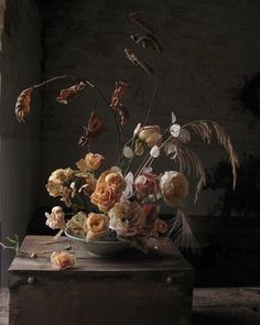 Instead of digging. The very last roses from my tired garden and a few dried summer treasures