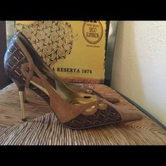 Like new Michael Antonio Gold Heels These have been worn a couple times.. Very neat heels.. Mix of Browns and the designs on side of heel are very cute.. The heel is gold colored . Michael Antonio Shoes Heels