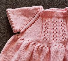 Cuddles DK Little Girl's Dress (detail): raglan sleeves, eyelet accents, picot hem ~~ Free pattern by Gail Tanquary for Crystal Palace Yarns