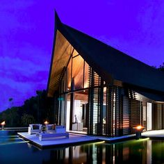 A nighttime look at this beach-front mansion and pool in Thailand designed by Jean-Michel Gathy. Credit for this modern home: Hunter | Sotheby's International Realty