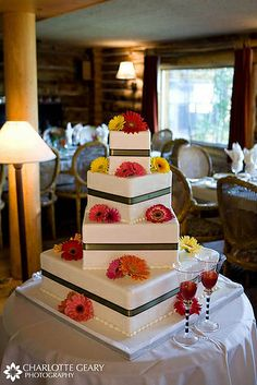 Square wedding cake with gerbera daisies