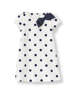 Chic dots infuse our soft cotton blend ponte knit dress with classic style. Puffed shoulder design features a dotted grosgrain ribbon bow at the neck for sweet charm. Coordinating bloomer completes the ensemble (sizes up to 18-24 months only). Buttons in back assist with dressing.
