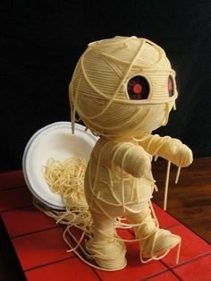 Mummy Noodle yarn cake first entry for Threadcakes! I'm excited to be participating this year :) The mummy stands 14 inches tall and s...