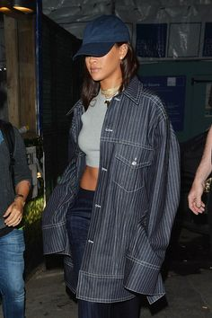 Rihanna completing her denim ensemble with a denim peak cap.