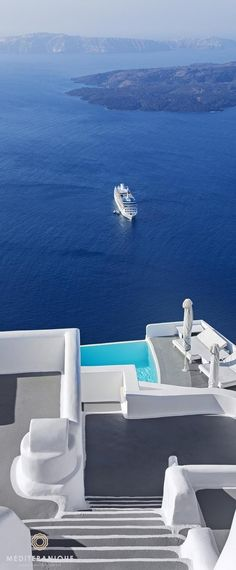 Captivating views over the volcano from the luxurious Cycladic style Chromata Hotel in Santorini