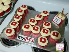 The 14th Birthday cake i  made for my You Tube obsessed son for his birthday!! I shaped the cupcakes into the number 14 & made the red play buttons out of Fondant & put one on each cupcake. I made the You Tube wording using my craft supplies. He loved it!! You Tube themed birthday cake, cupcakes in the shape of 14