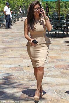 Kim looking good in peplum