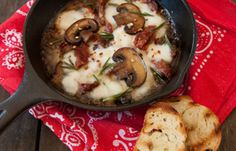 Melted Mozzarella Dutch Oven Dip With Mushrooms And Sun Dried Tomatoes | This yummy dip is perfect for eating around the fire. #survivallife www.survivallife.com
