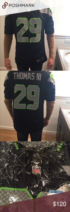 Seahawks Earl Thomas jersey NFL.com never been worn Seahawks jersey. Men's size medium. Still in plastic it was shipped in.   Pictures of the jersey are the exact jersey that my boyfriend has. Shirts