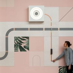 Wallpaper brand Flavor Paper has collaborated with furniture company UM Project to create an installation comprising wall tiles decorated with conductive inks, spread across a millennial pink backdrop.