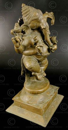 Image from http://www.antique-arts-asia.com/catalog/images/Bronze-statue-dancing-Ganesha-09KB3Bb.jpg?osCsid=58992afbe6bc050083764604c32fb598.