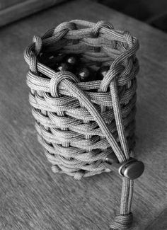 A woven and half hitched paracord pouch, that I made to hold the 1/2 inch  marbles I use for small monkey's fists and turks head knots.  It ...