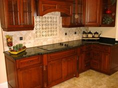 Color scheme for our counter tops and cabinets. Ours are a little more modern.   Google Image Result for http://atlanticcountertops.com/wp-content/uploads/2012/04/raleigh-kitchen-countertop-1.jpg