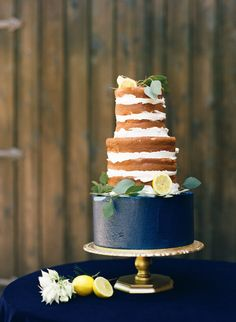 Naked cake with a navy base: http://www.stylemepretty.com/2014/10/28/romantic-navy-italian-inspired-wedding/ | Photography: Ashley Bosnick - http://ashleybosnick.com/ & Tracy Enoch - http://www.tracyenochphotography.com/