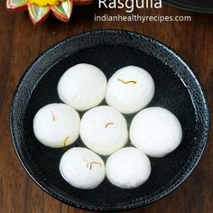 Rasgulla recipe - Soft, spongy and juicy rasgulla recipe with step by step photos. Coconut Ladoo Recipe, Rasgulla Recipe, Idli Recipe, Samosa Recipe, Masala Recipe, Indian Snacks, Indian Food Recipes, Diwali Recipes, Indian Desserts