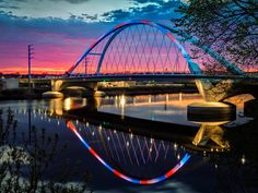 Lowry Sunset by Greg Lundgren on Capture Minnesota // The dying sun left just enough magenta in the sky to enhance the Lowry Bridge and its reflection.  It was lit red, white, and blue to celebrate Worker Memorial Day - April 28.  The wind - or lack thereof -  was quite cooperative as well.  This is a 5 image bracket (-2 to +2) merged with photomatix natural.
