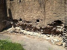 A recent photo of the Castro Pretorio, the ancient fortified headquarters of the Imperial guard, illustrating its plight: bricks and pieces of stone lining the surface are separating from the concrete core of the wall.