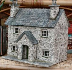 Stone style Dollhouse, the colorwork on these stones, the window setting, and the roof of this house are wonderful.