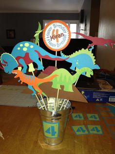 dinosaur birthday party centerpiece for a child. $22.00, via Etsy.